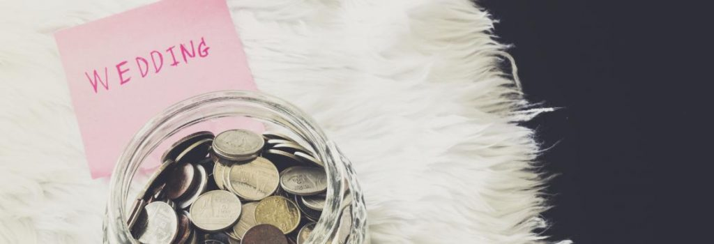 many-coins-in-a-money-jar-with-wedding-label-000063498213_Large